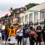 Protesters with the Black Lives Matter march down Pine Street on Juneteenth in West Philly. (Kimberly Paynter/WHYY)