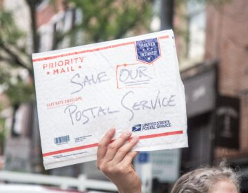 The American Postal Workers union local 89 and other labor supporters protest in Old City demanding the postal service be fully funded. (Kimberly Paynter/WHYY)