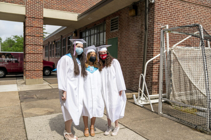 Ashley with friends on graduation day at Little Flower Catholic School for Girls in Hunting Park. (Jessica Kourkounis for Keystone Crossroads)