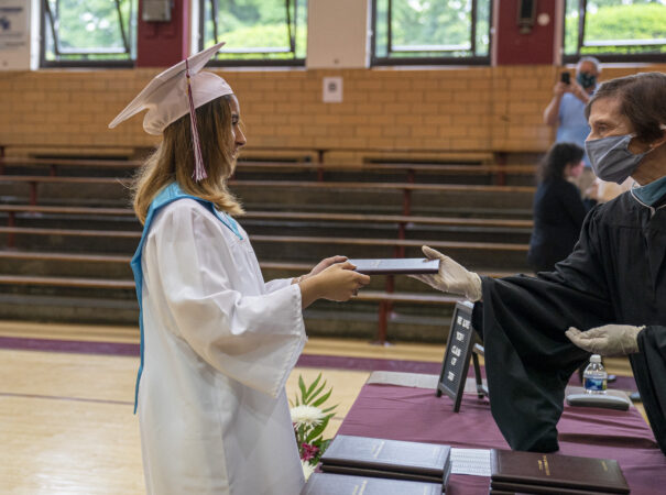 Ashley receives her diploma on graduation day at Little Flower Catholic School for Girls in Hunting Park. (Jessica Kourkounis for Keystone Crossroads)