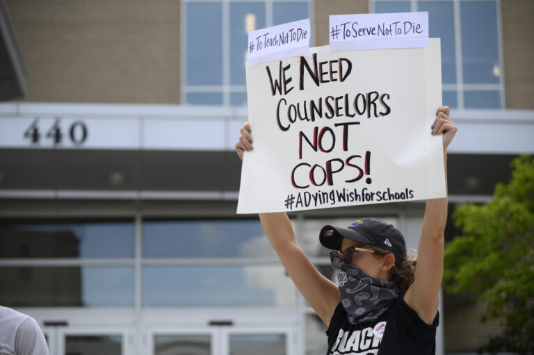 Teachers and students rallied outside of the School District of Philadelphia Headquarters calling to eliminate asbestos in school buildings. (Bastiaan Slabbers for WHYY)