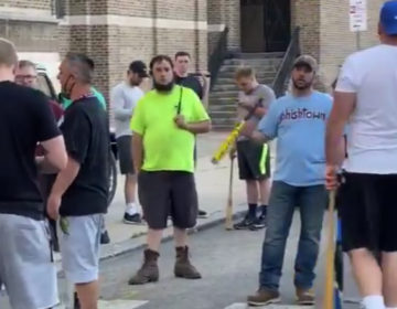 White bat-wielding men in Fishtown, who said they were there to protect police, assaulted at least three people during a protest on Monday. (Screenshot via Twitter)