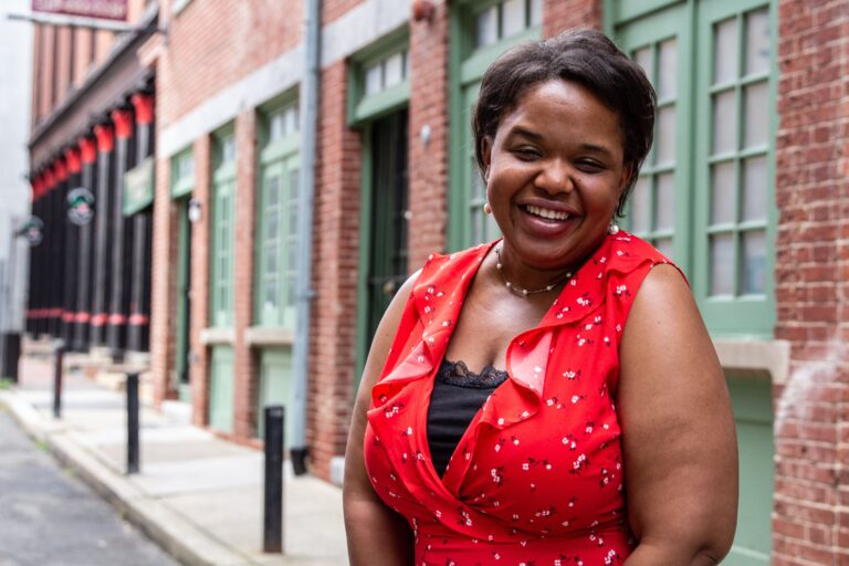 Writer Talia Stinson out in her Old City neighborhood (Kimberly Paynter/WHYY).