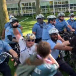 Philly police officers clash with protesters. The man identified as Staff Inspector Bologna is at center in a white shirt. (Screenshot via @Peopledelphia)