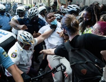 Police and protesters clash Saturday, May 30, 2020, in Philadelphia, during a demonstration over the death of George Floyd. Protests were held throughout the country over the death of Floyd, a black man who died after being restrained by Minneapolis police officers on May 25. (AP Photo/Matt Rourke)