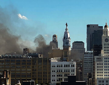 Smoke rises from cars on fire during the widespread protests in Philadelphia (Danya Henninger/Billy Penn)