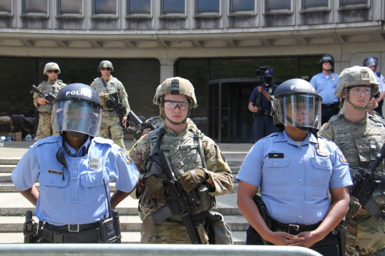 National guard troops help protect Philadelphia police headquarters during a series of protests aimed at police brutality. (Emma Lee/WHYY)