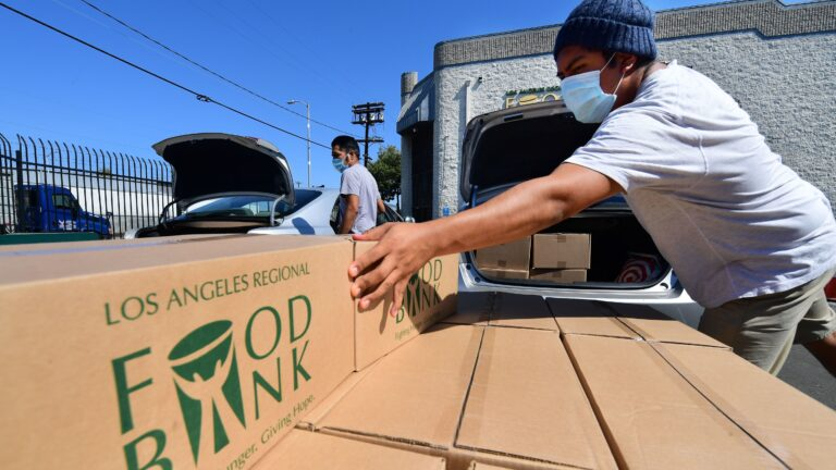 Boxes of food at are loaded at the Los Angeles Regional Food Bank on May 5. The country has officially entered a recession amid the pandemic, the National Bureau of Economic Research said Monday.