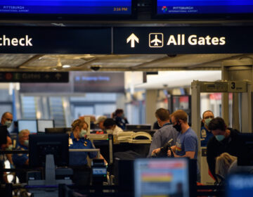 Travelers make their way through ticketing and TSA inspection at the Pittsburgh International Airport on May 7. (Jeff Swensen/Getty Images)
