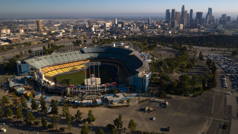 Dodger Stadium in Los Angeles stands empty in an aerial view from late May. Games will resume in late July. (Bing Guan/Bloomberg via Getty Images)