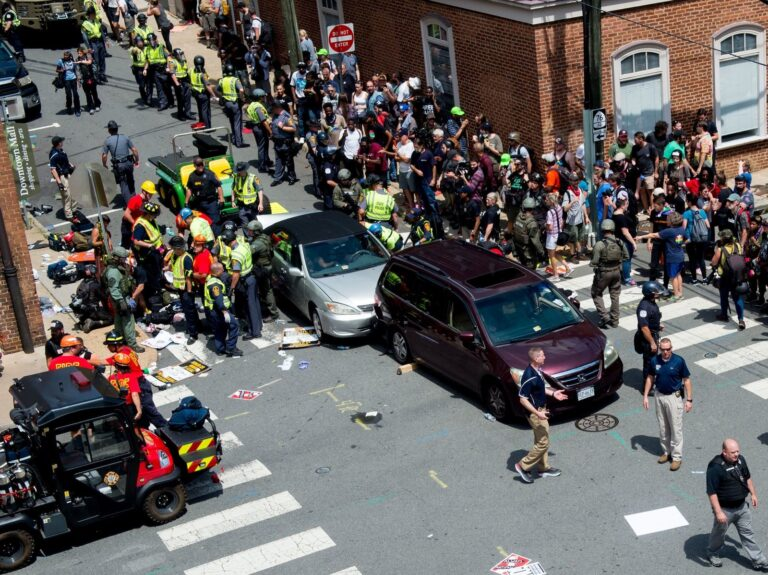 People receive first-aid after a driver ran into a crowd of protesters in Charlottesville