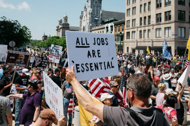 Protesters hold signs during a May 15, 2020, rally outside the state capitol in Harrisburg, Pa. About 1,000 people showed up to protest Gov. Wolf's coronavirus shutdown order. (Katie Landis/PA Post)