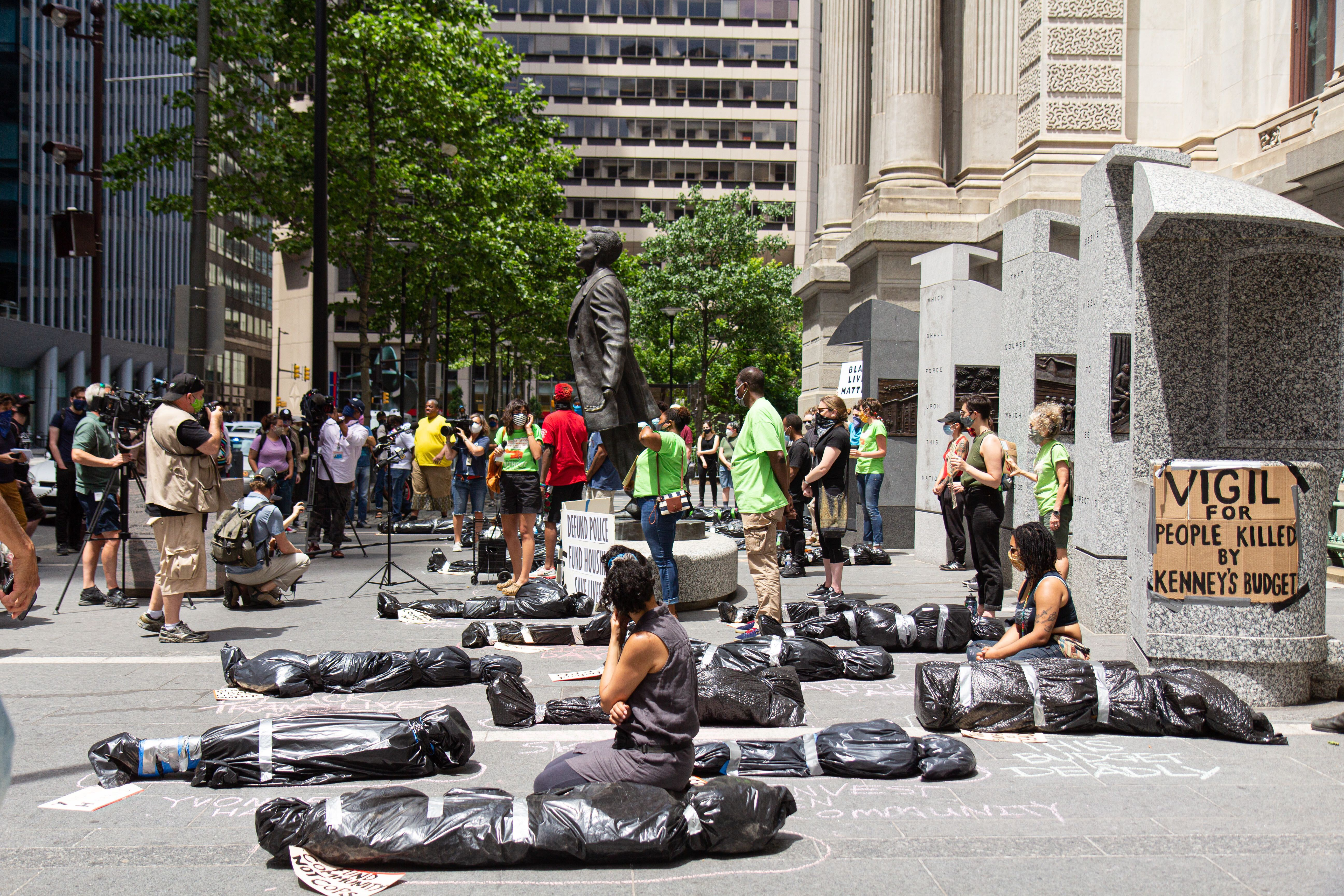 "Activists with the Philadelphia Coalition for Affordable Communities and others held a ""Vigil for People Killed by Kenney's Budget"" at City Hall, demanding the city defund the police and fund affordable, accessible and integrated housing."