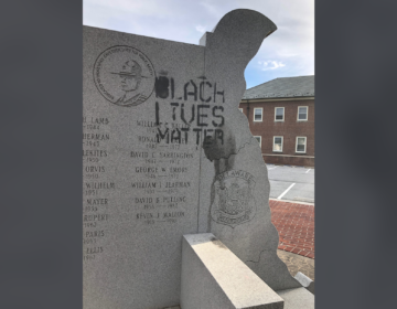 Someone spray painted 'Black Lives Matter' on a memorial dedicated to state police troopers killed in the line of duty located outside State Police headquarters in Dover. (Courtesy of Delaware State Police)