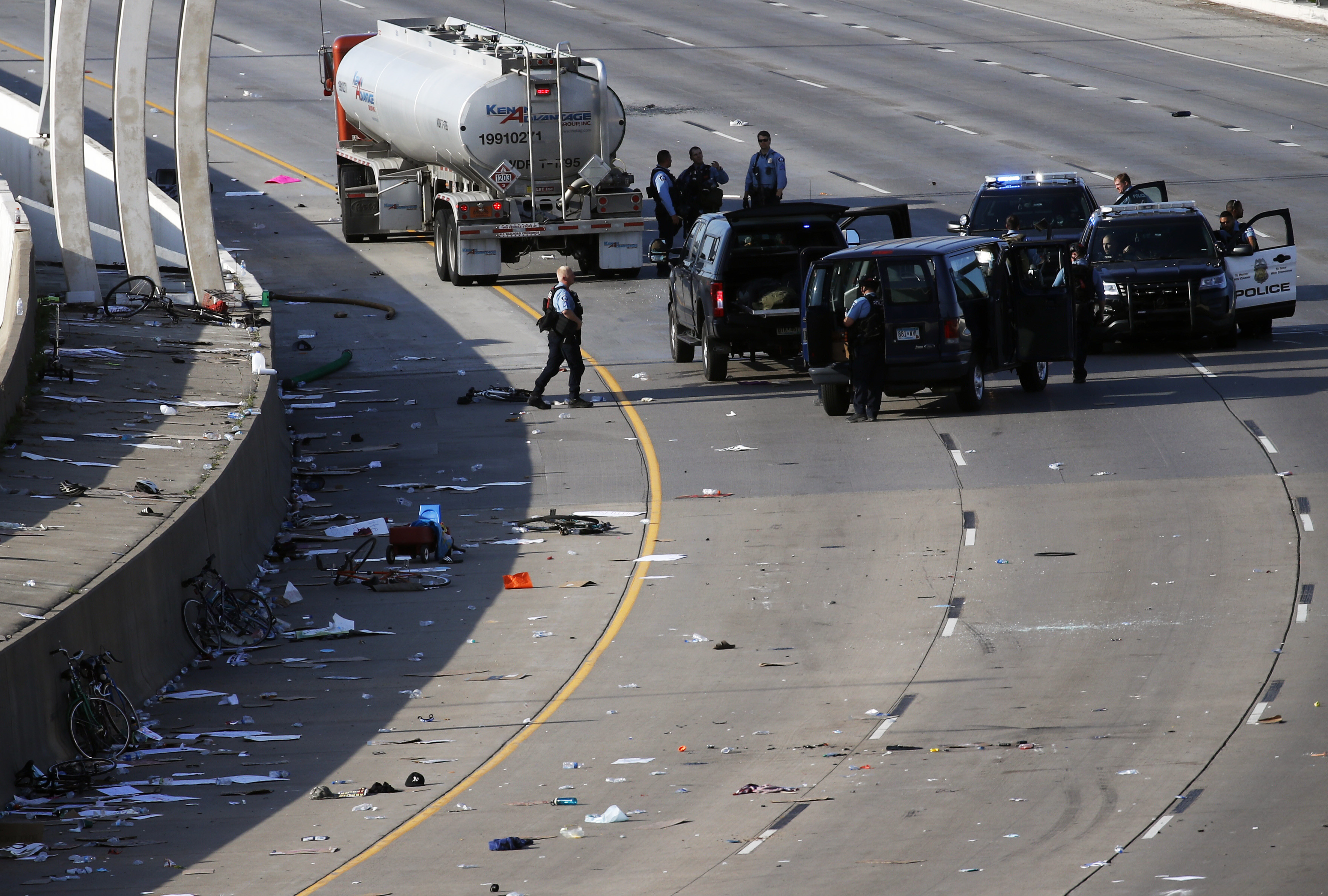 Police clear the area where a tanker truck rushed to a stop among protesters on an interstate highway on Sunday in Minneapoli