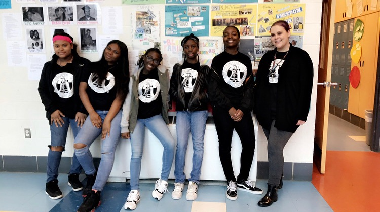 Aubrey Stewart, right, with some of her students at Feltonville Arts and Sciences. (Courtesy of The Notebook)