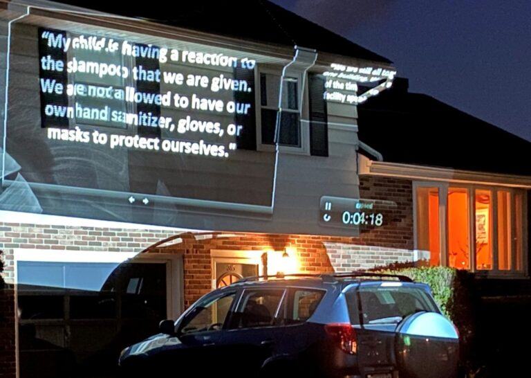 Protesters calling for the release of families held at the Berks Detention Center used a projector to illuminate the outside of Berks County Commissioner Michael Rivera's home on Monday, June 29, 2020. (Anthony Orozco / PA Post)