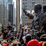 Protesters attacked the Frank Rizzo statue in front of MSB on Saturday. (Emma Lee / WHYY)