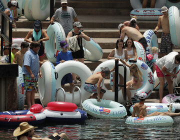 Tubers prepare to float the Comal River in New Braunfels, Texas, on Thursday, despite the recent spike in COVID-19 cases. Texas Gov. Greg Abbott said Wednesday that the state is facing a