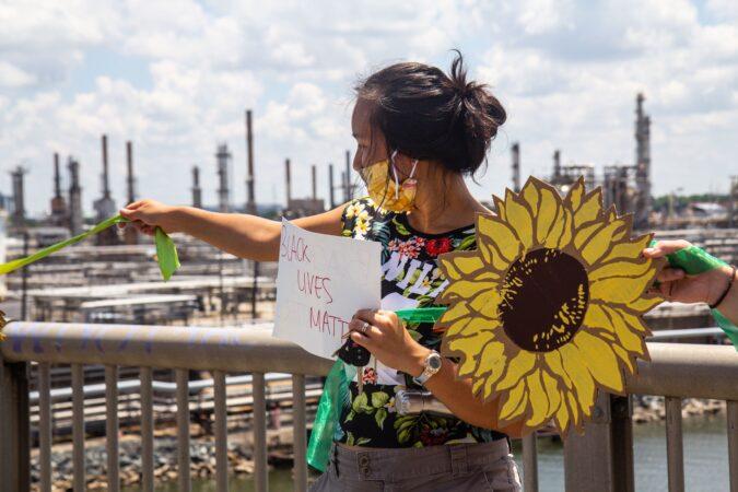 "Andie Ayala holds a ""Black Lives Matter"" sign"