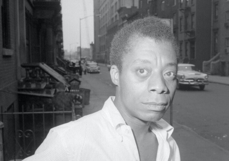 Author James Baldwin is shown on a Harlem street in New York City, June 3, 1963.  (AP Photo/stf)