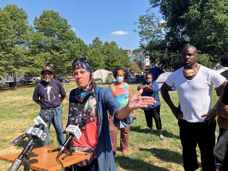 Jennifer Bennetch of Occupy PHA speaks on behalf of residents of a protest encampment at 21st Street and Ridge Avenue, which the city has ordered closed by Friday. (Susan Phillips/WHYY)