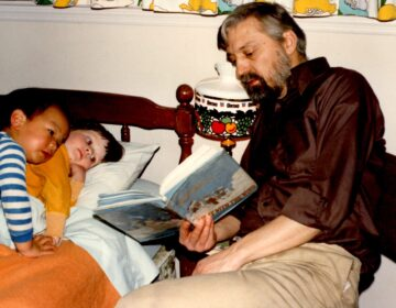 Hugh Frick reads to his children, Tim and Tegan, in a photo taken circa 1980. (Courtesy of Tim Frick)