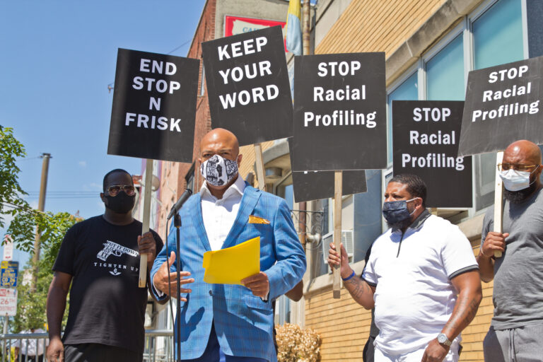 Will Mega of the Human Rights Coalition 215 stood with other activists outside Philadelphia Police's 26th district precinct to demand an end to stop-and-frisk policies in the city. (Kimberly Paynter/WHYY)