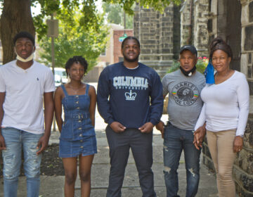 CJ Thompson (center) with his parents Oneita and Clive Thompson-Lewis (right), and his siblings, Christine, 17, and Timothy, 14. (Kimberly Paynter/WHYY)