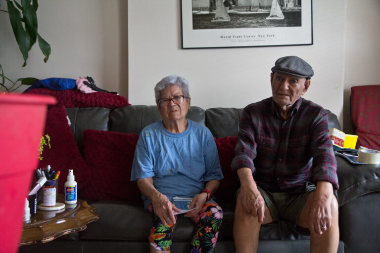 Gloria and Hugo Nievas just bought an air conditioner to install in their Hunting Park home. (Kimberly Paynter/WHYY)