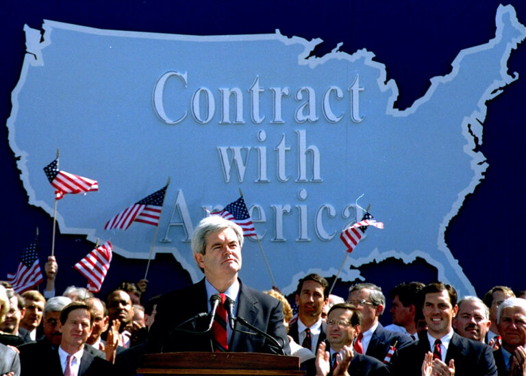 In this Sept. 27, 1994 photo, then-House Minority Whip Newt Gingrich of Ga., pauses while speaking to Republican congressional candidates on Capitol Hill during a rally where they pledged a