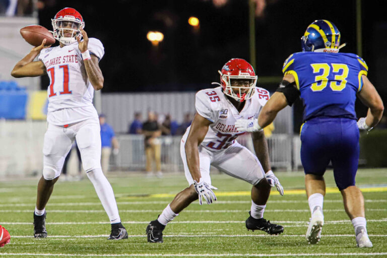 August 30, 2019, Newark, Delaware, U.S: Delaware State quarterback SHAYNE SMITH (11) attempts a pass to the end zone during a week one game between the Delaware Blue Hens and Delaware State Thursday, AUG. 29, 2019, at Tubby Raymond Field at Delaware Stadium in Newark, DE. (Credit Image: © Saquan Stimpson/ZUMA Wire) (Cal Sport Media via AP Images)