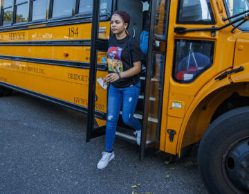 A student gets off the bus for the 1st day of school at Oakcrest High School on Tuesday. Sept. 3, 2019. (Craig Matthews/The Press of Atlantic City via AP)
