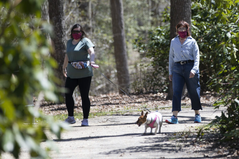 People wearing a protective face coverings hike at Shark River Park in Wall Township, N.J., Saturday, May 2, 2020. (AP Photo/Matt Rourke)