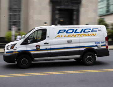 An Allentown, Pa., police van is driven near City Hall on Friday, May 29, 2020.  (AP Photo/Matt Rourke)