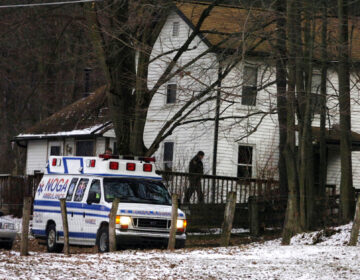 FILE - In this file photo from Feb. 21, 2009, an ambulance is parked outside the farmhouse where Kenzie Marie Houk was killed in Wampum, Pa. Jordan Brown, who was eleven-years-old at the time was charged in the shooting death of the 26-year-old pregnant mother of two. He is now filing a wrongful prosecution and conviction lawsuit, alleging that the state police investigators knowingly disobeyed protocols, fabricated and manipulated evidence to further a fake narrative that he was guilty. (AP Photo/Beaver County Times, Kevin Lorenzi, File)