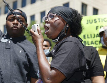 In this June 27, 2020, file photo, Sheneen McClain speaks during a rally and march over the death of her 23-year-old son Elijah McClain, outside the police department in Aurora, Colo. (AP Photo/David Zalubowski)