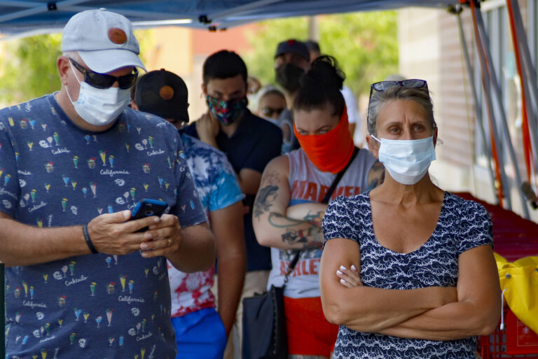 People waiting in line to enter a grocery store wear COVID-19 protective masks, Friday, July 3, 2020, in McCandless, Pa. (AP Photo/Keith Srakocic)