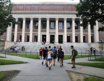 In this Aug. 13, 2019 file photo, students walk near the Widener Library in Harvard Yard at Harvard University in Cambridge, Mass. The Ivy League school announced Monday, July 6, 2020, that as the coronavirus pandemic continues its freshman class will be invited to live on campus this fall, while most other undergraduates will be required learn remotely from home. (AP Photo/Charles Krupa, File)