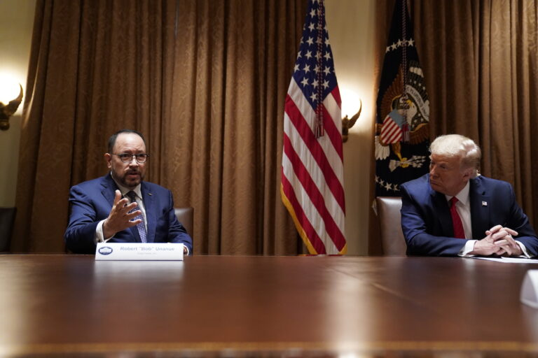 President Donald Trump listens as Robert Unanue, of Goya Foods, speaks during a roundtable meeting with Hispanic leaders in the Cabinet Room, Thursday, July 9, 2020, in Washington. (AP Photo/Evan Vucci)