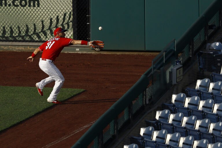 Philadelphia Phillies' Nick Martini catches a fly ball hit by Josh Harrison during an intrasquad baseball game Tuesday, July 14, 2020, in Philadelphia. (AP Photo/Matt Slocum)