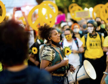 In this July 22, 2020 file photo Black Lives Matter organizer Teal Lindseth, 21, leads protesters in Portland, Ore. (AP Photo/Noah Berger)