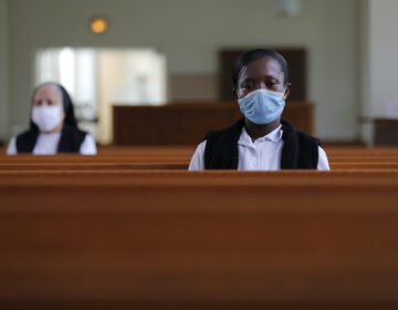 Faustina Bema, a candidate for Novice of the Sisters of the Holy Family, prays inside a chapel during a retreat at their Mother House in New Orleans, Thursday, July 23, 2020. (AP Photo/Gerald Herbert)
