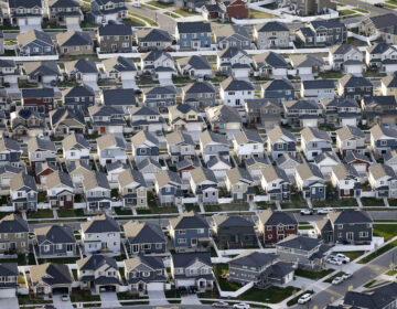 This April 13, 2019, file photo, shows rows of homes, in suburban Salt Lake City.  (AP Photo/Rick Bowmer)