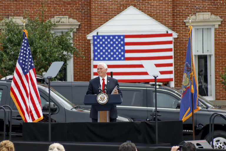 "Vice President Mike Pence speaks  at a ""Cops for Trump"" campaign event at the police station Thursday, July 30, 2020, in Greensburg, Pa. (AP Photo/Keith Srakocic)"