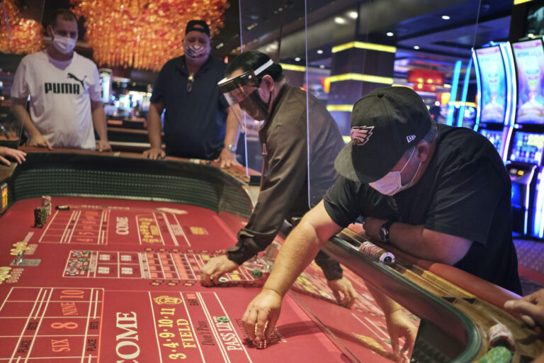 Craps players and dealers are seperated by partitions at the Golden Nugget Casino
