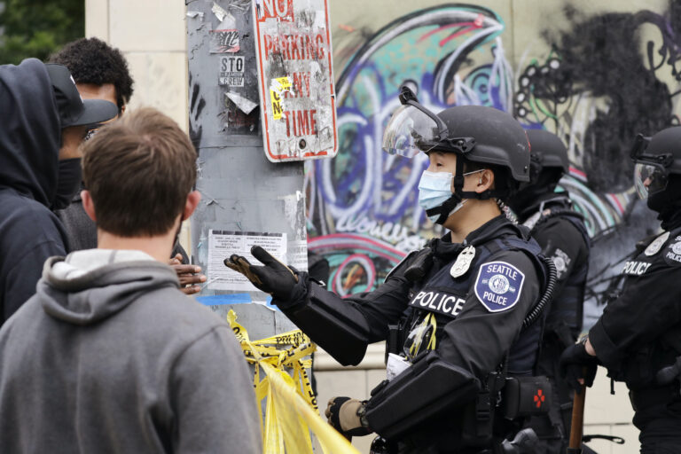 A police officer engages with a protester
