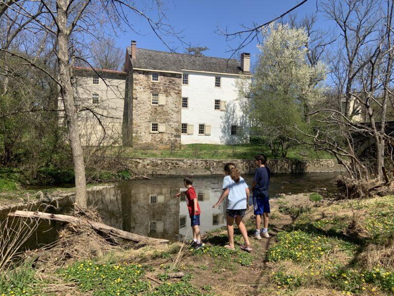 Kids exploring the Wissahickon creek near the historic Evans-Mumbower Mill. (Photo by Julie Watt)