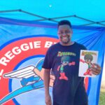 Comic book author Reggie Byers was selling copies of his latest book, 'AFROBOY AND PUFFGIRL' at the street fair in Media. (Zachariah Hughes/WHYY)