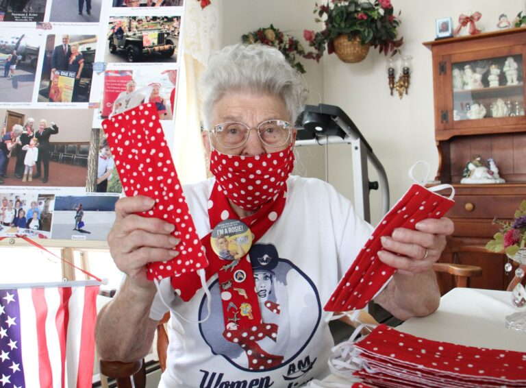 Mae Krier is busy sewing face masks in the 'Rosie the Riveter' pattern at her home in Levittown, Pa. (Emma Lee/WHYY)